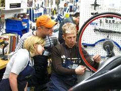 John, Service Manager, showing some students how to true a wheel.